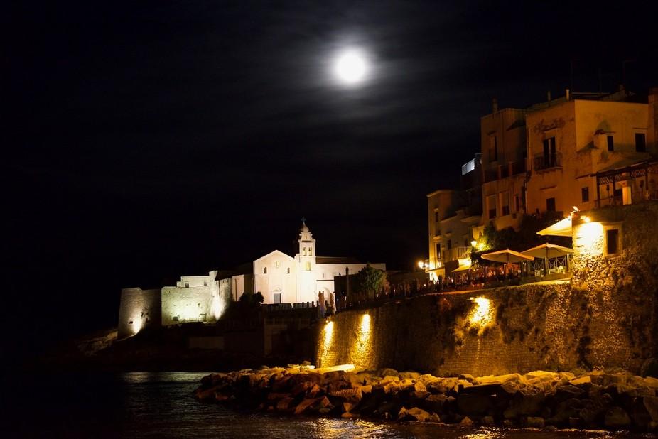 Still moonlight night in the small city in Italy