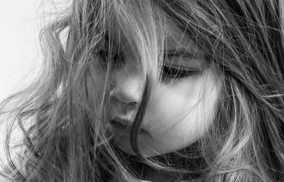 Black and White image of a child with messy hair