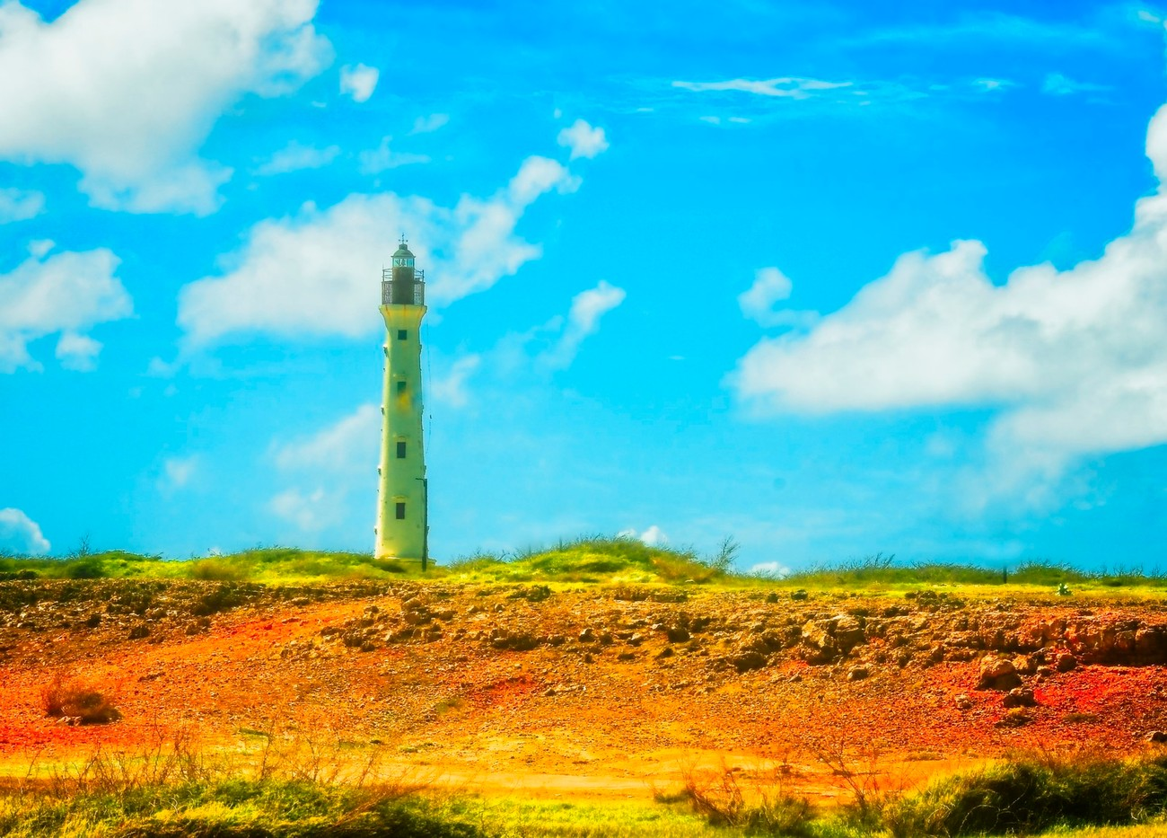 An old lighthouse at the end of the island is very old, and popular among the tourists in Aruba. The views seem better from the front and back of it.