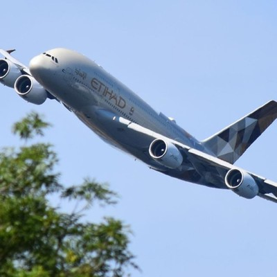 Civil jets don't get much bigger than this! Etihad A380 departs Heathrow over Windsor.