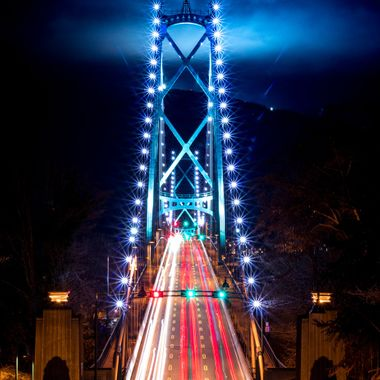 Took this night long exposure of Beautiful Lions Gate Bridge. Always wanted to capture this specific set of clouds covering the sky with ski lifts lighting cloudscape.