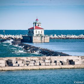 Oswego Harbor West Pierhead Lighthouse is an active aid to navigation located off the coast of Oswego, New York. It was built in 1934 to replace ...