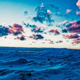 Cotton candy clouds and gentle seas.  Lawrence D. Griffin