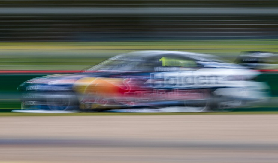 Slow shutter image of the #1 Red Bull HRT Holden of Jamie Whincup at speed during the Australian Grand Prix