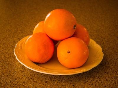 Oranges in a dish.