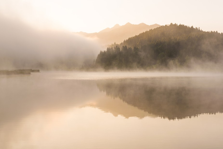 Misty summer morning at lake Geroldsee in the Alps of Bavaria