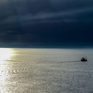 Heddin oot ti sea as the sun goes down
