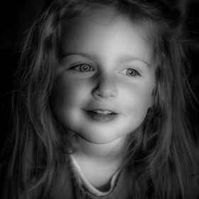 A b/w portrait image of our granddaughter Samantha ... a.k.a. Sam  Camera: Canon EOS REBEL T3i Aperture: f/2.8 ISO: 800 Shutter Speed: 1/50 Focal...