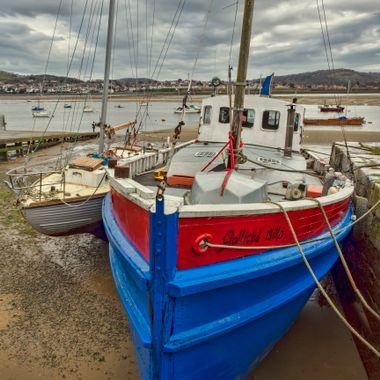 A colourful boat berthed at Conwy Harbour.