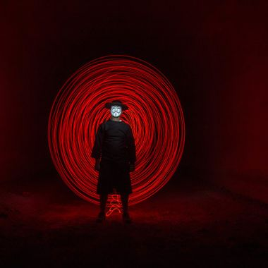 Standing in front or a red circle made with a simple little red bulb tied to a rope and turning it behind the guy for about 30 seconds.