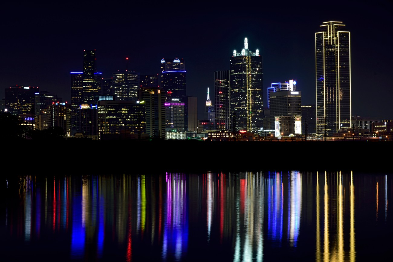 The Dallas skyline reflected in a pond.