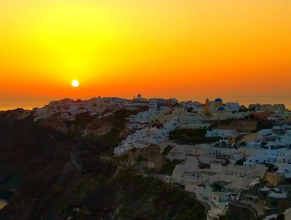 The Greek gods have ways to end a great day.  One of the many amazing sunsets in Oia, Santorini, ...