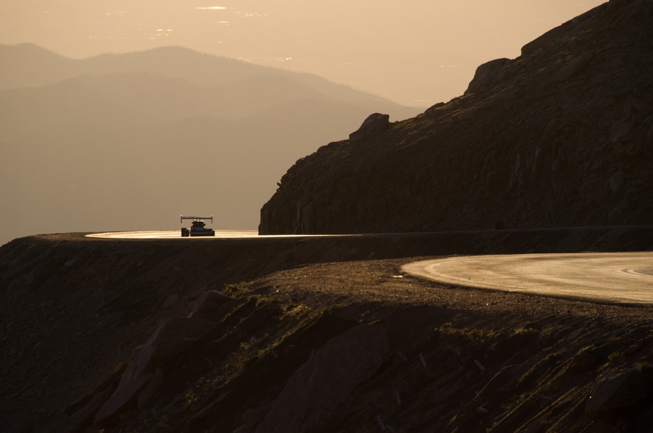 Race car driver coming around a hairpin turn during the 2013 Pikes Peak International Hill Climb ...