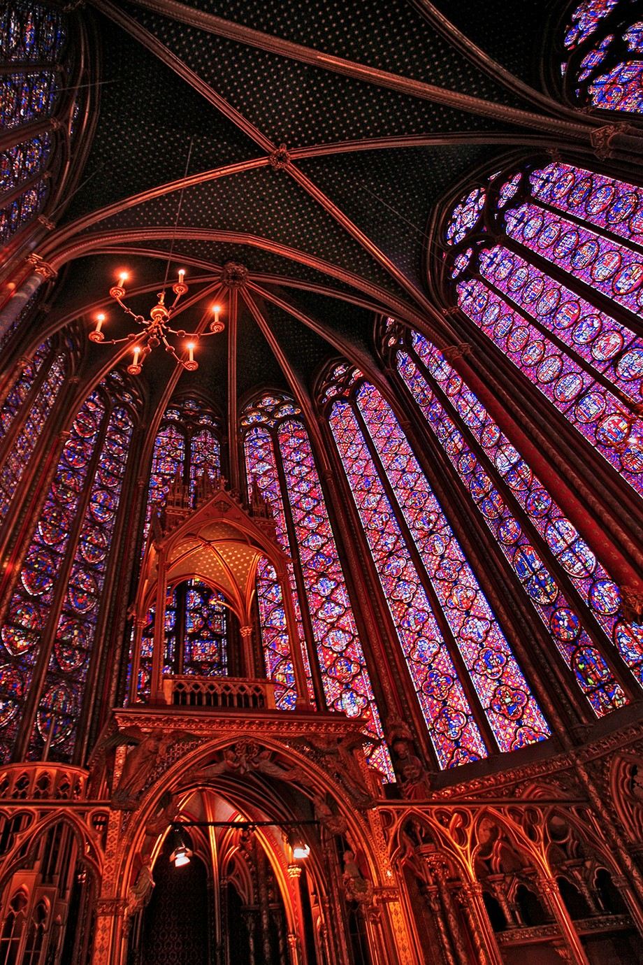 We went to Sainte-Chapelle to hear a string concert. My habit of always having a camera with me in Paris paid off. The warm sunset light through the stained glass windows, combined with the music and the chapel's acoustics, made for an absolutely transcendental experience.  Details: Canon EOS 5D, Canon 17-35 mm lens, at 17 mm, ISO 400, f/2.8, 1/30 sec.