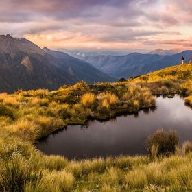 A dusk view across the tarn to our campsite and Mt Kendall, Biggs Tops, Kahurangi National Park, New Zealand