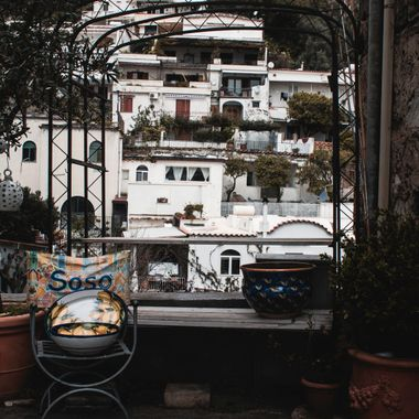 Artistic seat arch overlooking the sights of beautiful Positano, Italy,