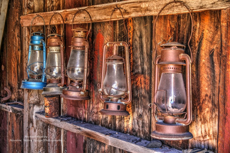 Inside the ghost town of  Bodie California hang these oil lanterns inside the old firehouse.