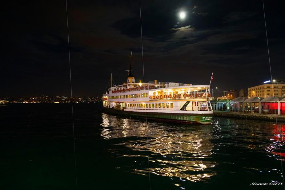 Ferry boat crossing the Golden Horn in Istanbul (Turkey). From Galata Bridge.