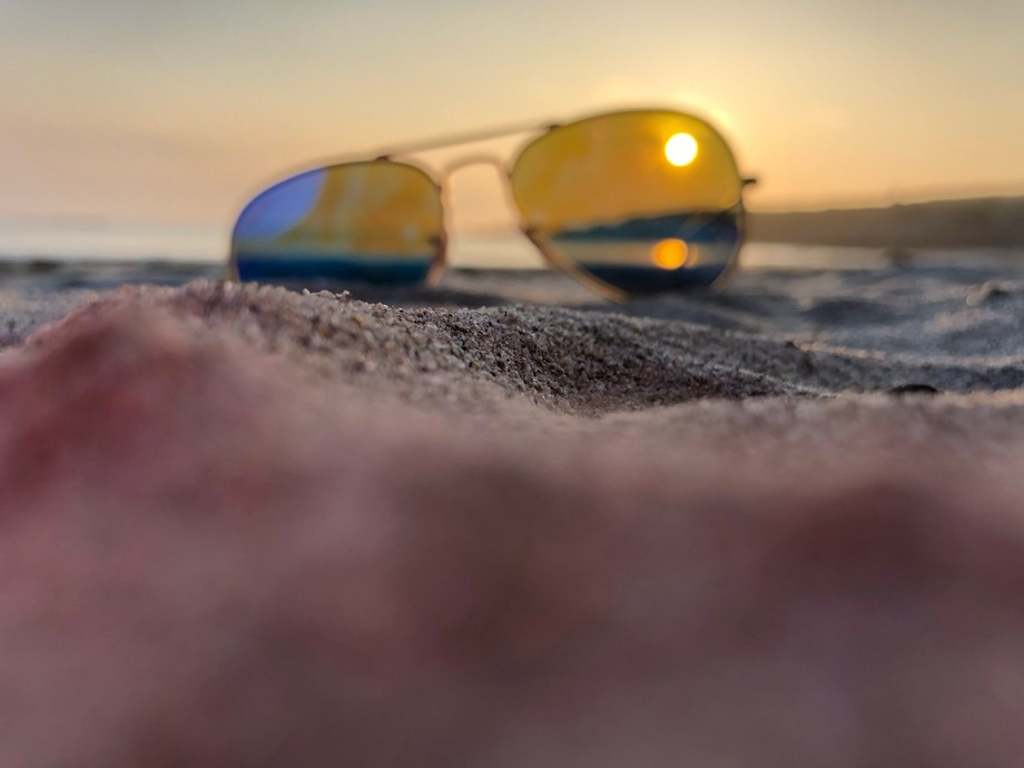 Unedited photo (sunglasses on the sand)