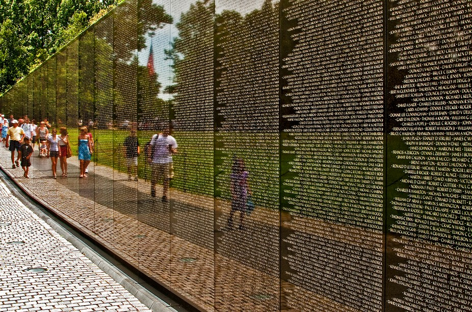 The Vietnam Wall inspires reflection, which this image captures. I wrote this Haiku--  On this somber wall,  Ephemeral reflections Move through silenced names.  Details: Canon EOS 40D, Canon 28-135 mm IS lens at 28 mm; ISO 400, f/14, 1/60 sec.