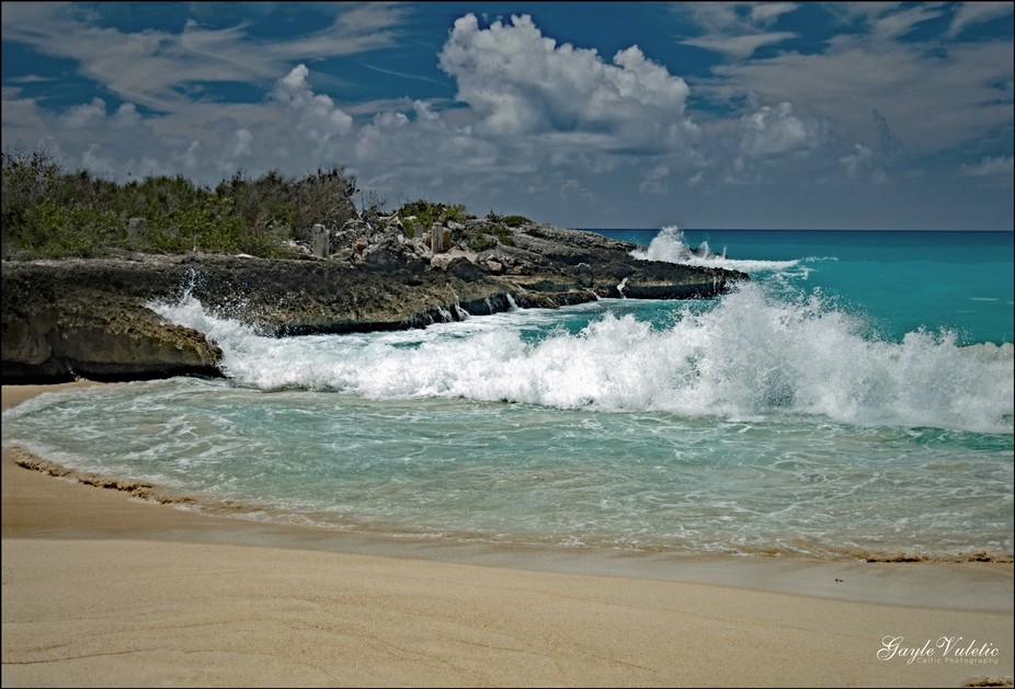 Took this at Maho Beach in St. Maarten. The waves were crashing against the land and it just look...