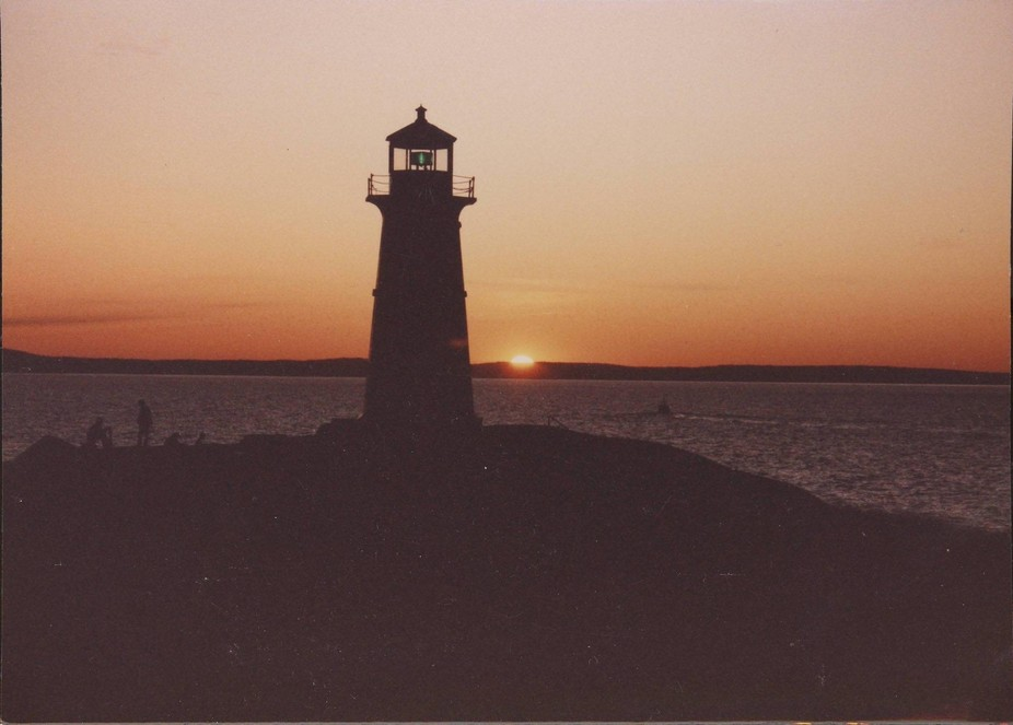 Peggy's Cove Lighthouse in Nova Scotia taken at sunset