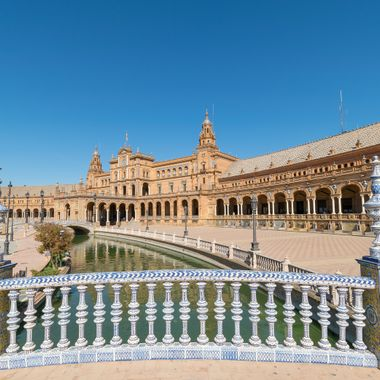 a beautiful view from on top of the bridge in front of the Plaza De Espana Seville, Spain