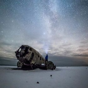 I never tire of visiting the abandoned plane wreck on the beach of Iceland under the Milky Way,