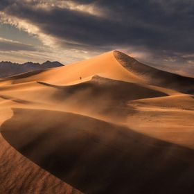 The Ibex Sand Dunes are an isolated set of beautiful sand dunes set against the backdrop of the Saddle Peak Hills at the southern end of Death Va...