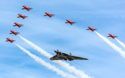 RAF formation flypast of Red Arrows display team and the last airworthy Avro Vulcan