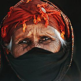 Portrait of a old woman wearing traditional Egyptian clothes