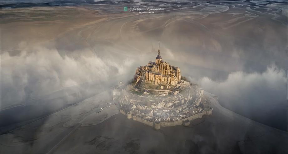 drone flight above the mist of Mont Saint Michel
