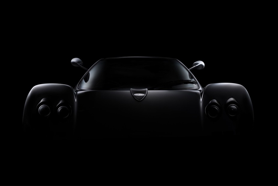I create this low-key effect on the Pagani Zonda C12 by using focused diffused light.