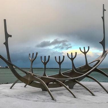 """Sólfar"", the steel sculpture by Jón Gunnar Árnason, is probably one of Iceland's most famous pieces of art. With amazing mountain-view, this Viking-ship-like sculpture is one of Reykjavík's most popular photo spots.  I took this image on a trip to Iceland in January of 2017 with my iPhone 8Plus. It was a totally overcast day except for a brief moment when a patch of blue sky opened up."