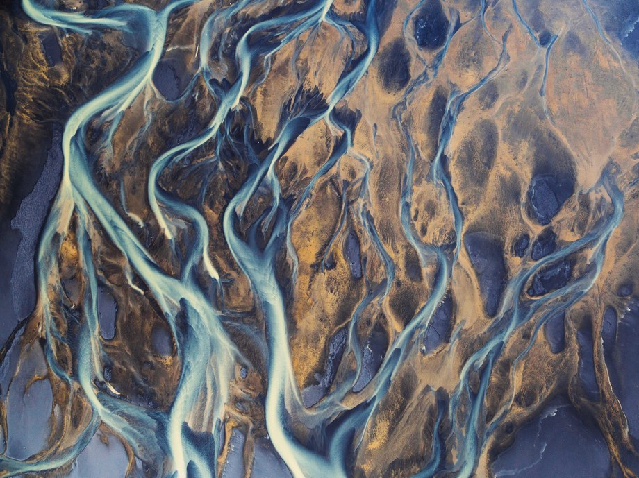 I took this aerial image of glacial melt mixing with geothermal rivers on a helicopter flight in ...