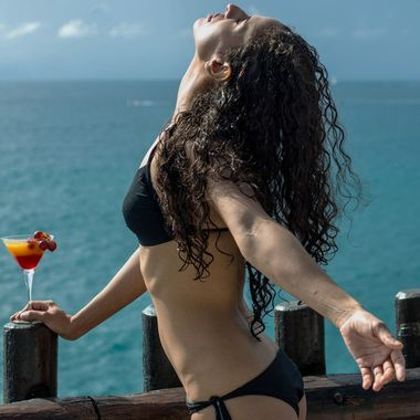 Karla drinking a coctail and sunbathing