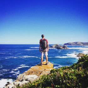 This photo was taken at Robberg, Plettenberg Bay, South Africa. My brother always gets the epic stand right.