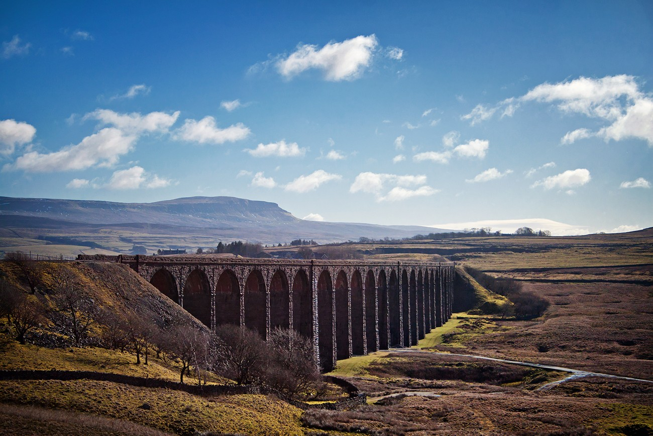 Looking from the slopes of Whernside over the Ribblehead Viaduct, towards the distant peak of Penyghent