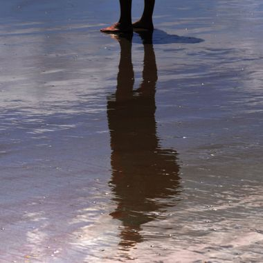 His Reflection and Feet in the Sand