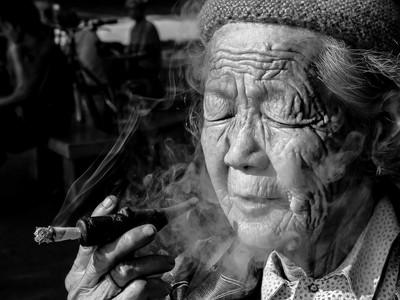 Old woman smoking pipe