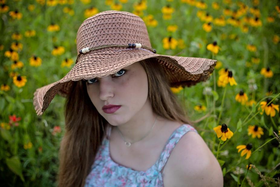 Beautiful girl in a field of yellow Texas wildflowers