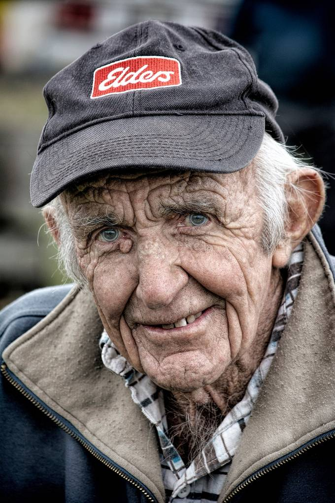 I took my camera to a farm sale and captured old local farmers and their well worn faces