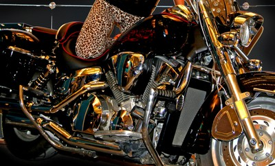 Mirror-chrome motorcycle with a girl. Photo 04