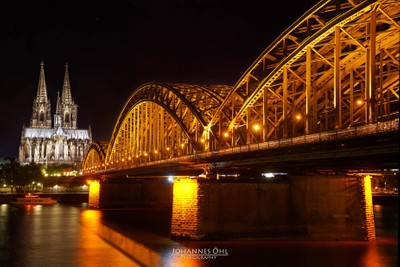 Illuminated Hohenzollern Bridge with Cathedral