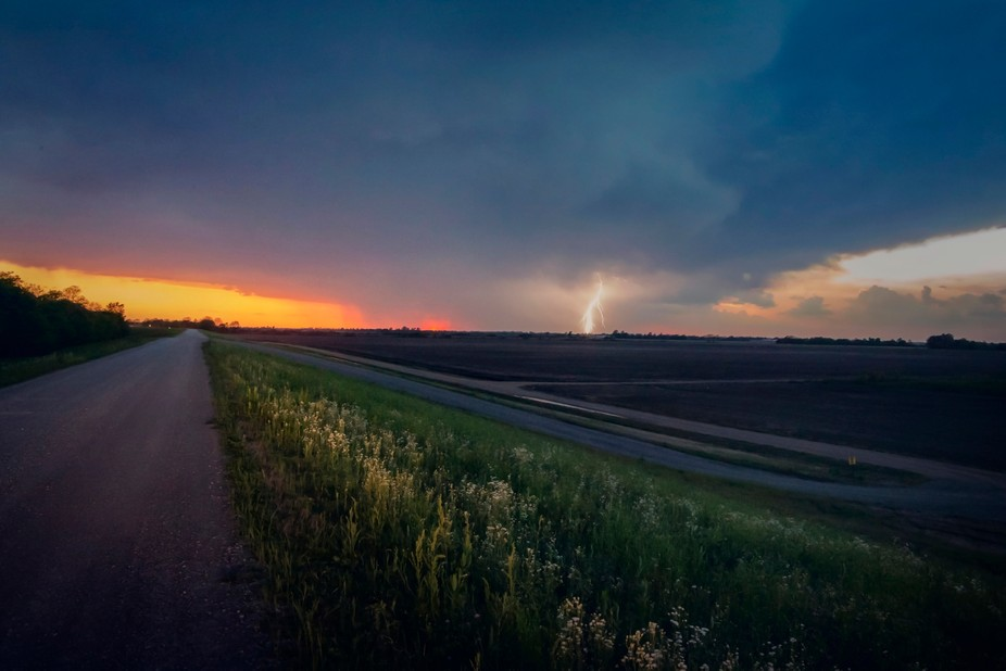 A spring storm moves in on the horizon as the sun sets on a rural Missouri day.