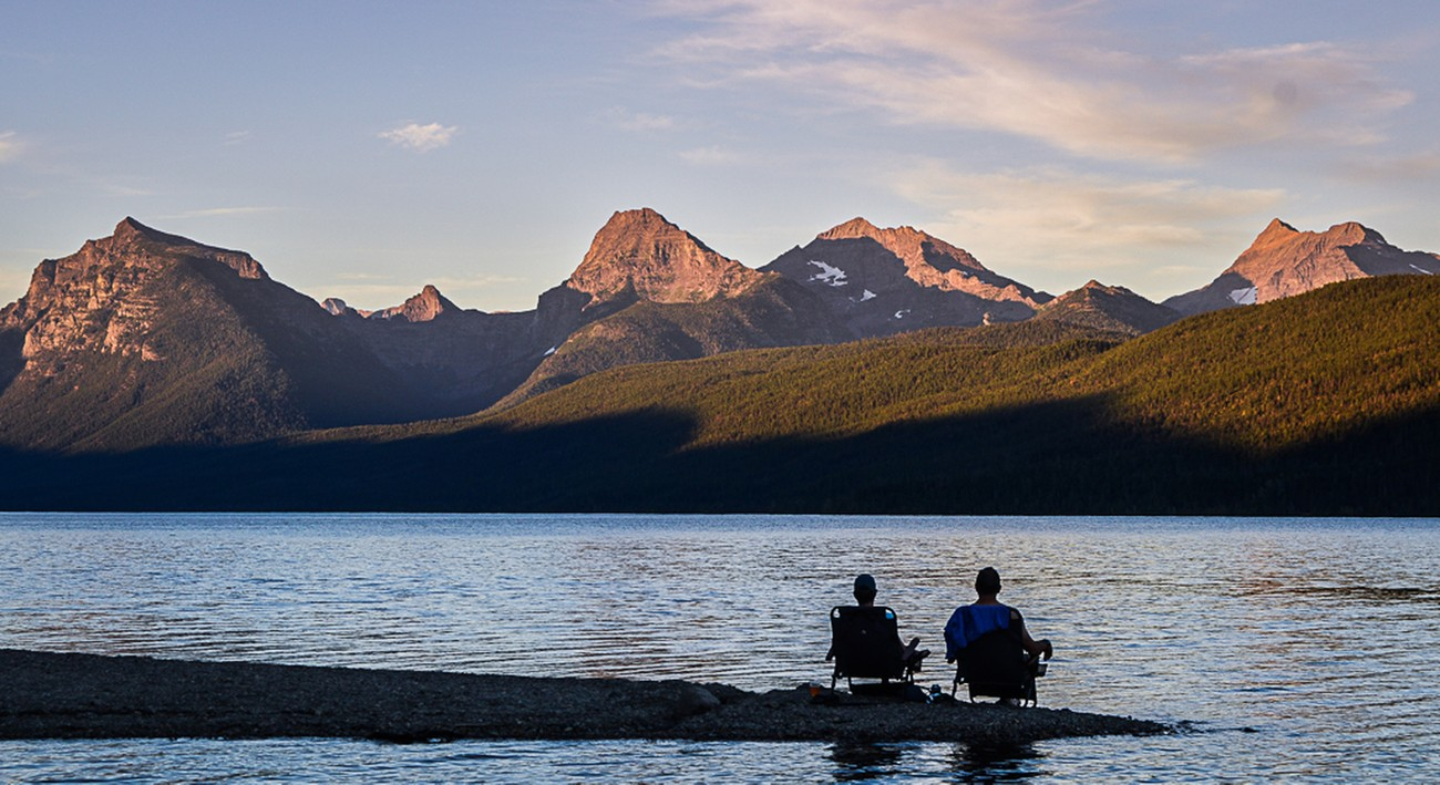 I loved the peaceful scene of  this couple enjoying McDonal Lake and the sun setting on the mountains in Glacier National Park.