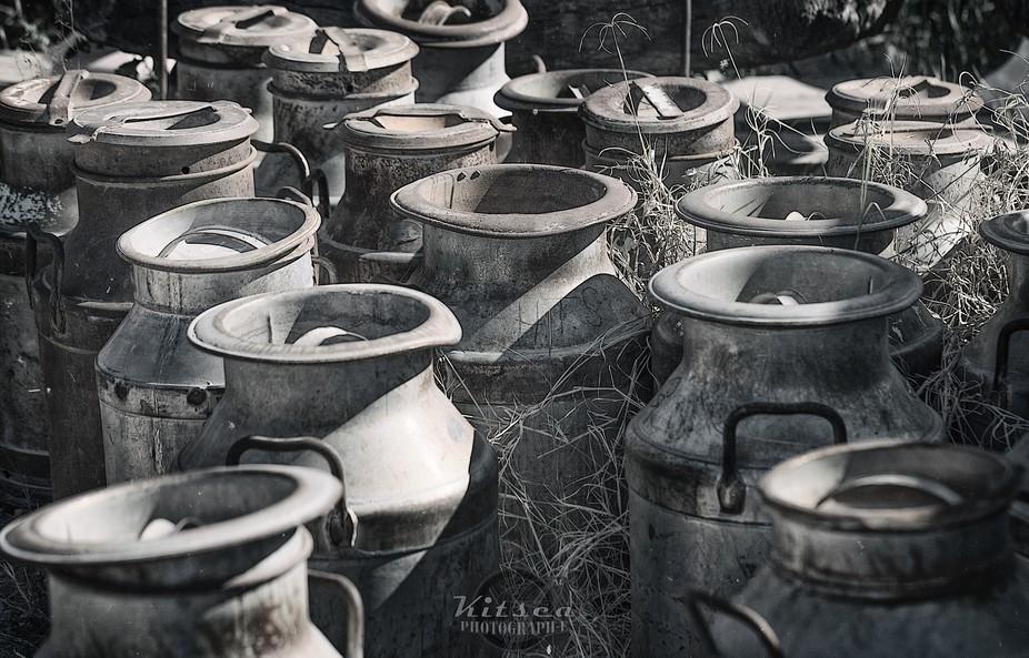 Antique milk containers in the desert sun