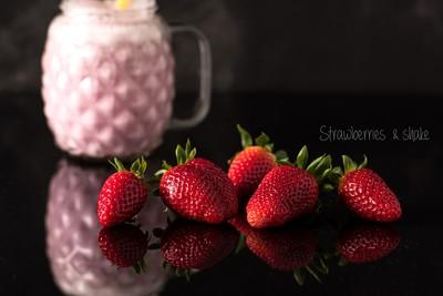 Strawberries on black background.