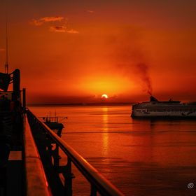 A beautiful red and yellow sun set off the island of Belize