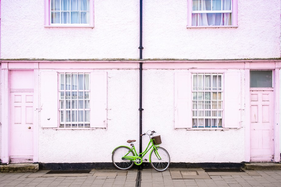 Green city bike parked against pink wall. Couldn't resist the symmetry and the color com...